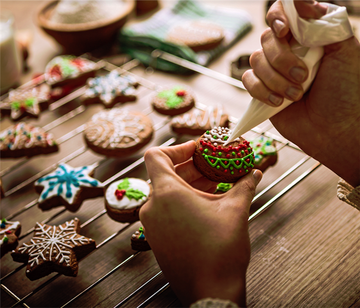 a person decorating cookies