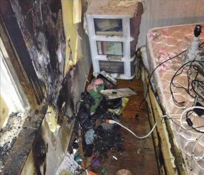 A room that suffered fire damage with soot and smoke covering all areas