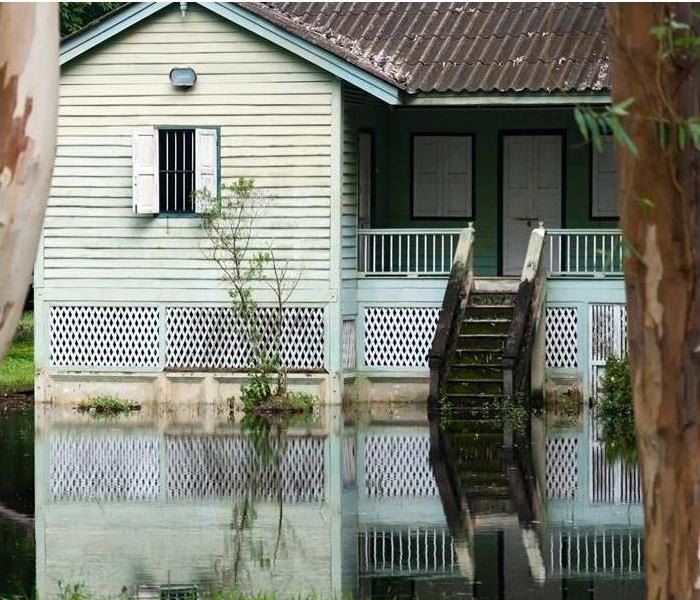 Floodwater surrounding Home