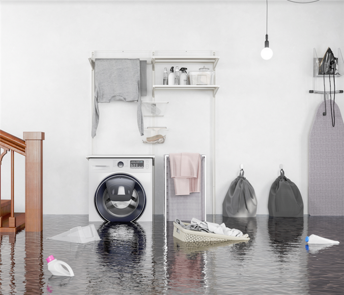flooded laundry room with items floating everywhere