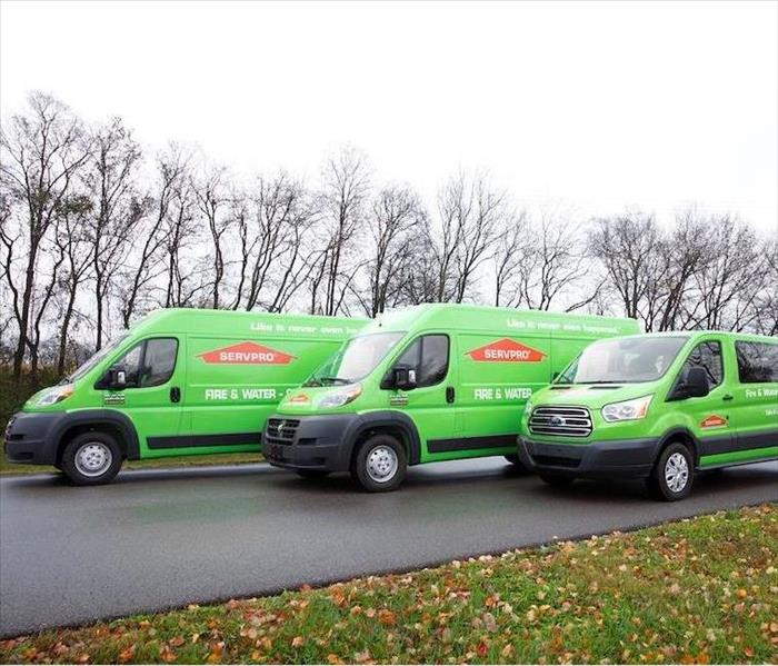 SERVPRO vehicles parked in front of home